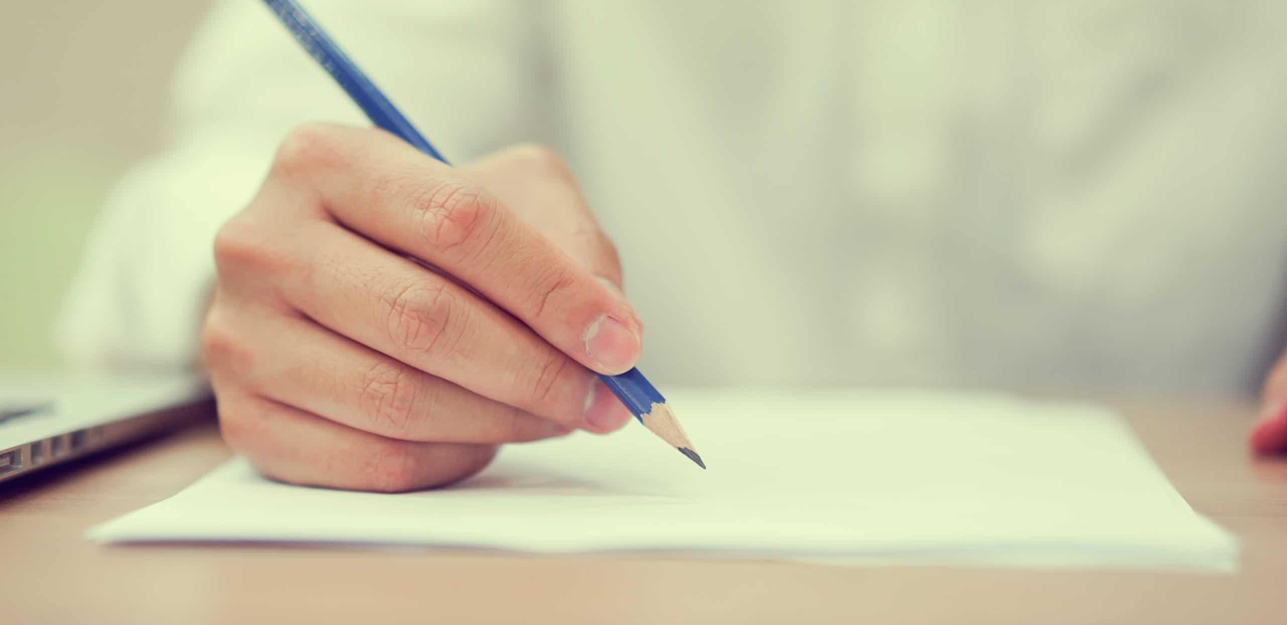 Close up man hand writing